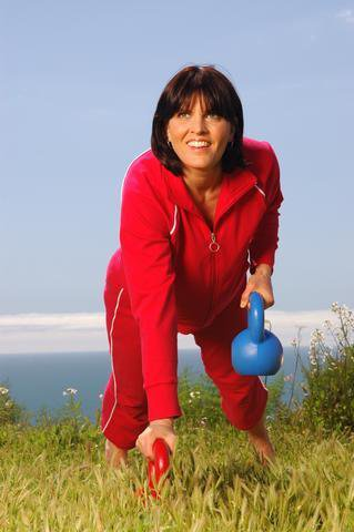Wendy Schauer working out with kettlebells in Pacific Palisades, California.